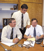 Picture of 2nd and 3rd Generations of W. Haut Specialty Co. From left to right: Paul Haut, Michael Haut and John Haut.